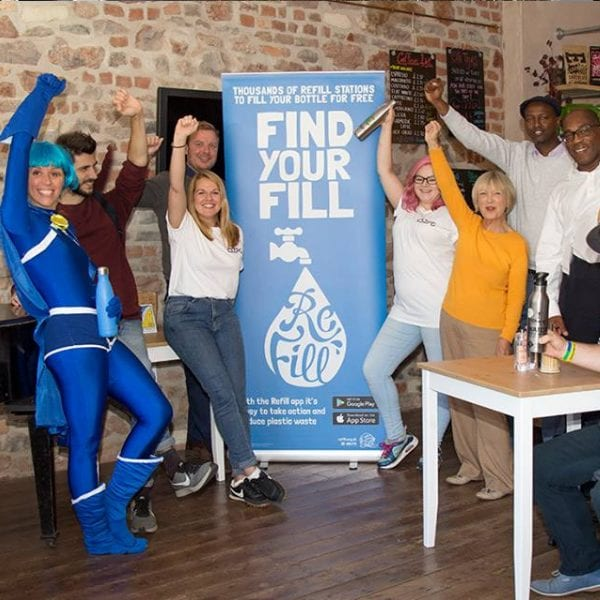 Michelle Cassar at Stapleton Road for a Bristol action day National Refill Day 2018, blue wig, people smiling holding bottles